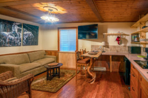 Doc-Holidays-cabin-–-Inside-the-door-–-Kitchen-and-Living-area-300x200.jpg