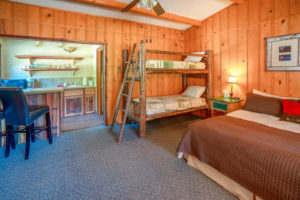 West-Beckwith-Cabin-–-King-Bed-Twin-bunkbeds-and-kitchen-300x200.jpg