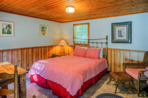 Hitching-Post-Cabin-–-checkered-bedding-and-chair-300x200.jpg